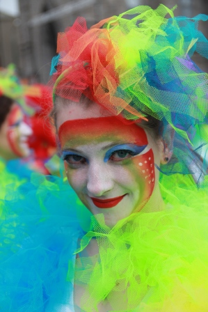 Rainbow Face paint party entertainers stilts street performers corporate events charity events themeed events