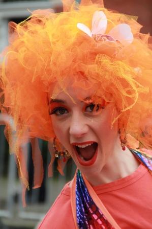 Orange street performer